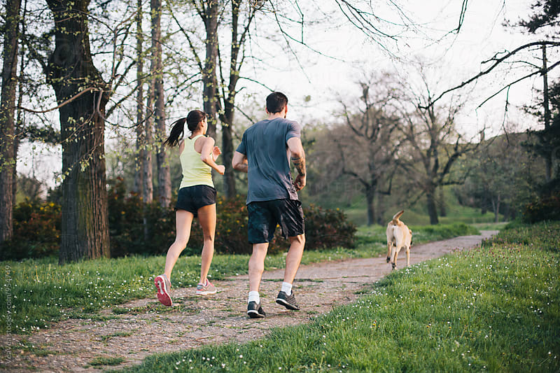Couple having a training outdoors by Marija Mandic for Stocksy United