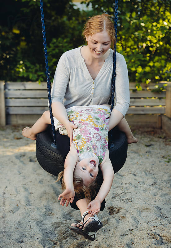 mother and daughter at the playground by Andreas Gradin for Stocksy United