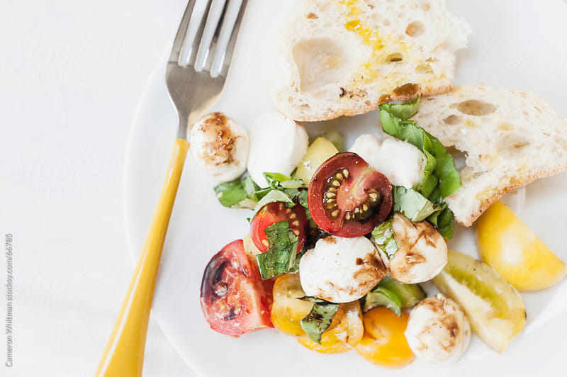 Heirloom Tomato Salad by Cameron Whitman for Stocksy United