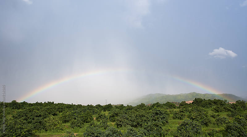 Rainbow with rain by zheng long for Stocksy United