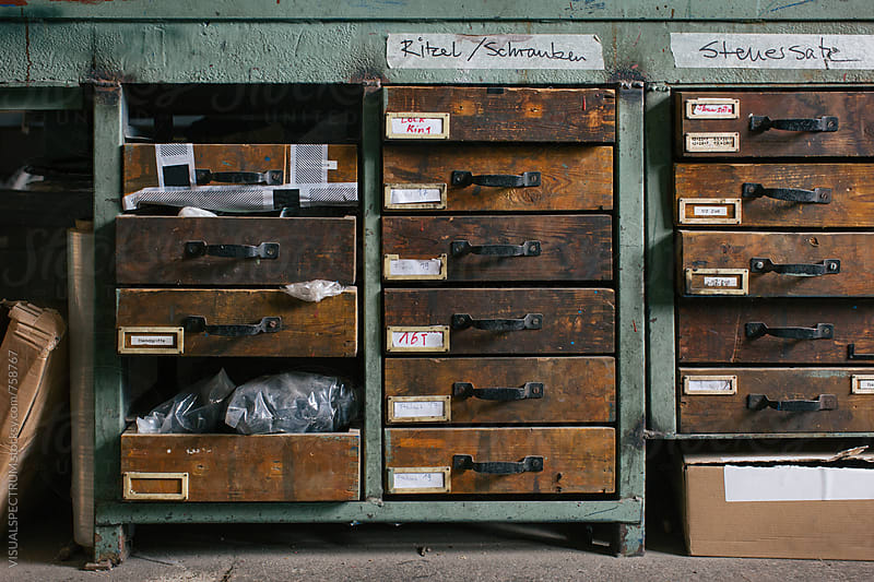 Wooden Drawers in Old Bicycle Repair Shop by VISUALSPECTRUM for Stocksy United