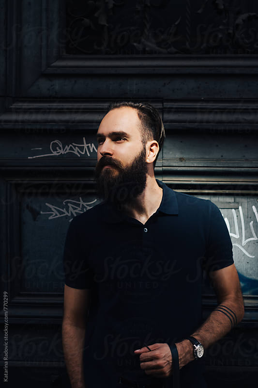 Portrait of a Handsome Bearded Man Standing on as Street by Katarina Radovic for Stocksy United