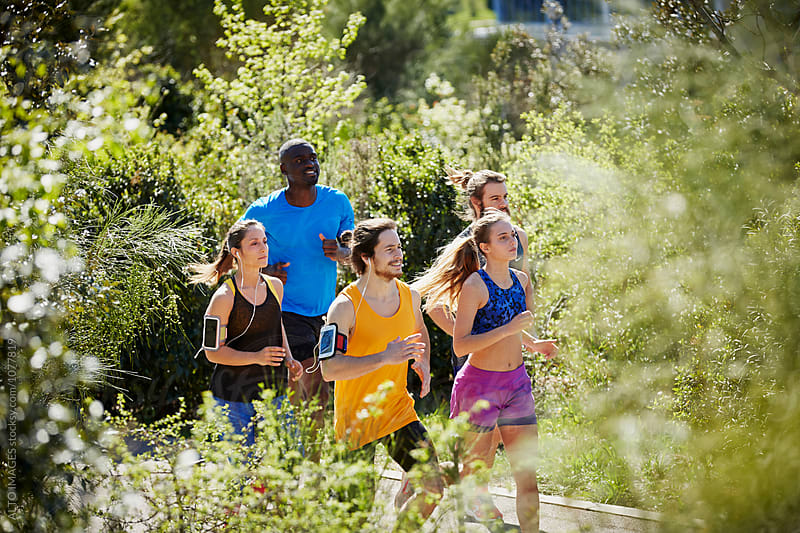 Multiethnic Friends Running Amidst Nature by ALTO IMAGES for Stocksy United