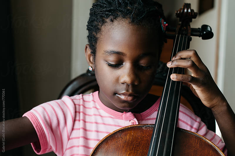 Black girl with cello by Gabriel (Gabi) Bucataru for Stocksy United