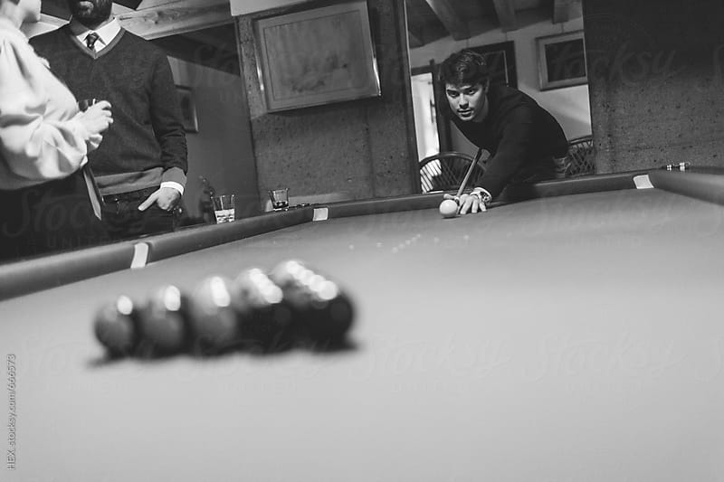 Friends Having Fun Playing Billiard in a Pool Table by HEX. for Stocksy United
