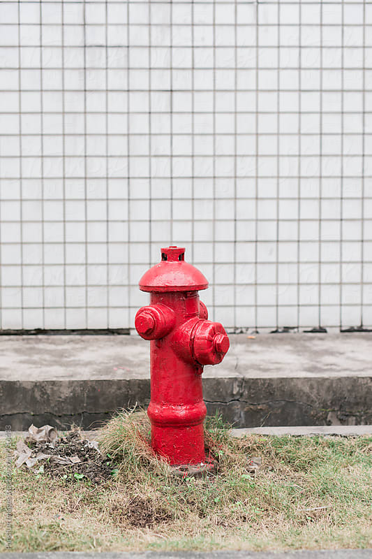 fire hydrant in city by Xunbin Pan for Stocksy United
