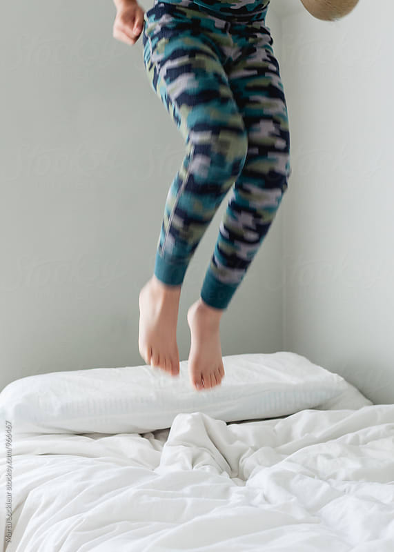 Jumping on the bed by Marta Locklear for Stocksy United