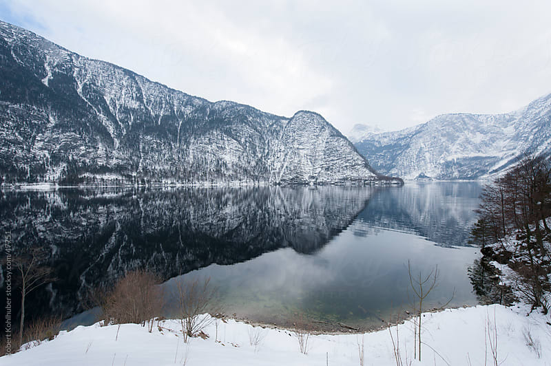 Lake hallstatt with mountains in austria  by Robert Kohlhuber for Stocksy United