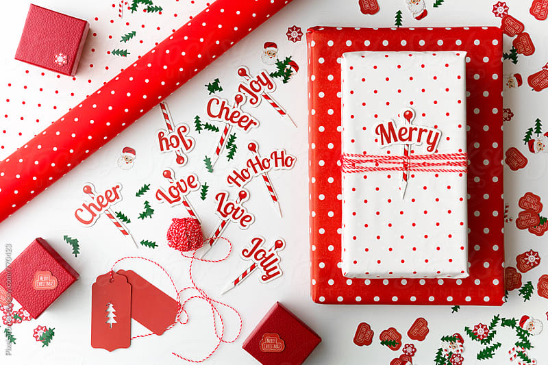 Red and white Christmas presents by Pixel Stories for Stocksy United