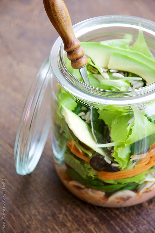 Mixed salad in a jar by Harald Walker for Stocksy United
