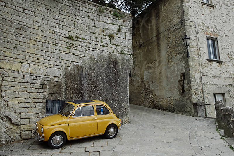 Old Yellow Car in San Marino by Aleksandra Jankovic for Stocksy United