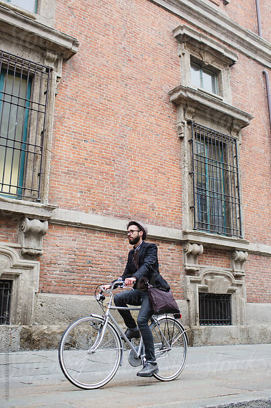 Young man around the city by bike by michela ravasio for Stocksy United