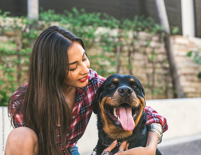 Beautiful young woman and her super happy dog. by Jovo Jovanovic for Stocksy United