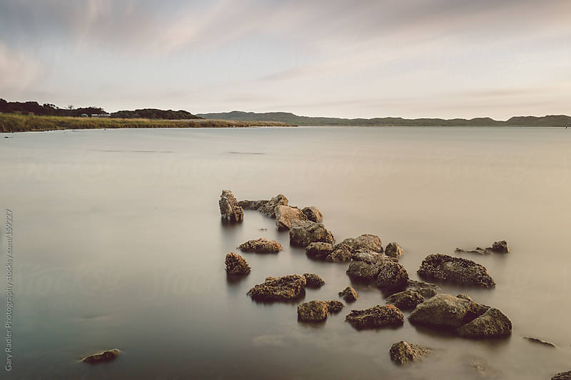Rocks on a Lake by Gary Radler Photography for Stocksy United