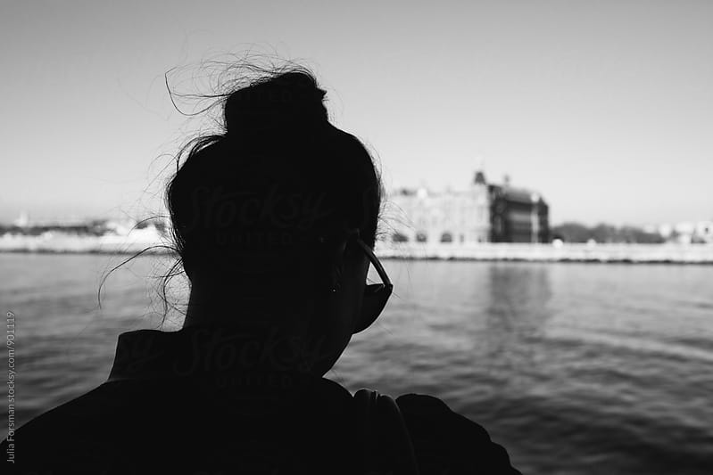 Silhouette of a woman with her hair pinned up travelling by boat in Istanbul. by Julia Forsman for Stocksy United