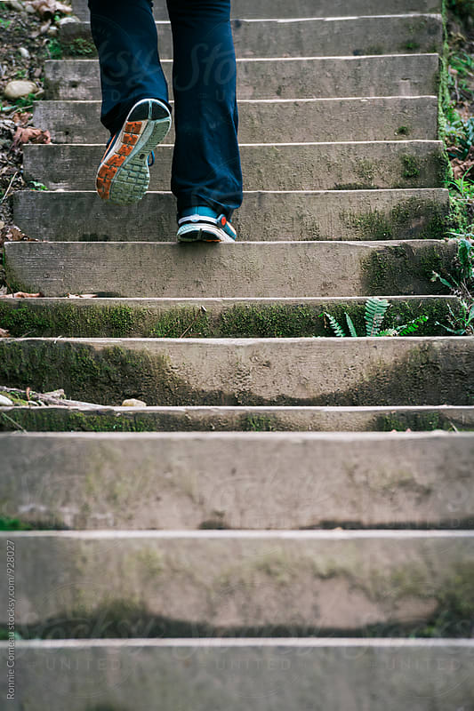 Person Climbing Steep Stairs For Fitness by Ronnie Comeau for Stocksy United