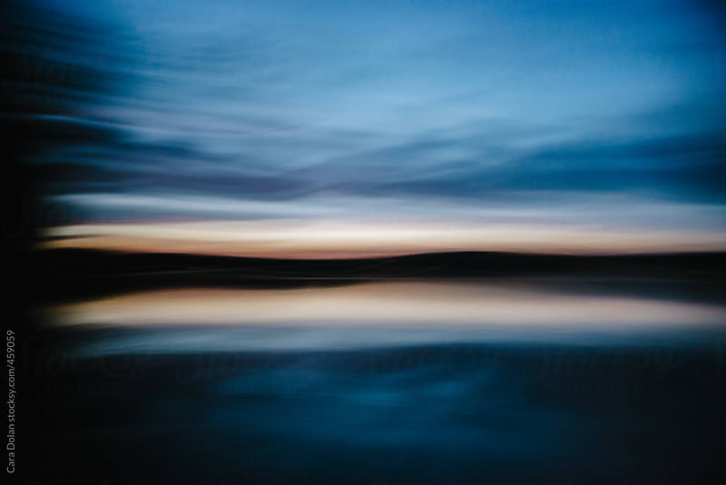 Lake water at dusk with motion blur by Cara Dolan for Stocksy United