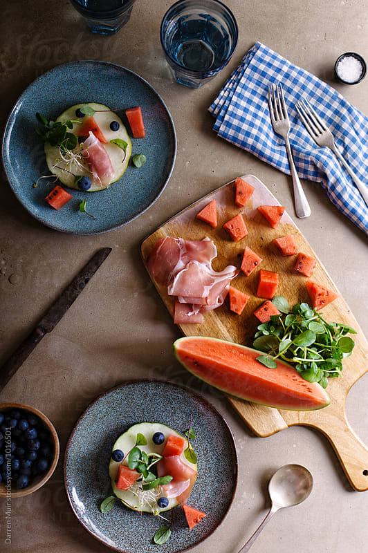 Prosciutto and melon salad. by Darren Muir for Stocksy United