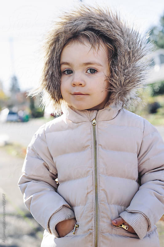 Child in a jacket by Ali Lanenga for Stocksy United