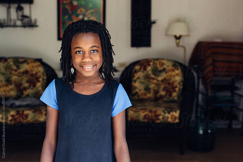 Smiling African American girl in a room by Gabriel (Gabi) Bucataru for Stocksy United