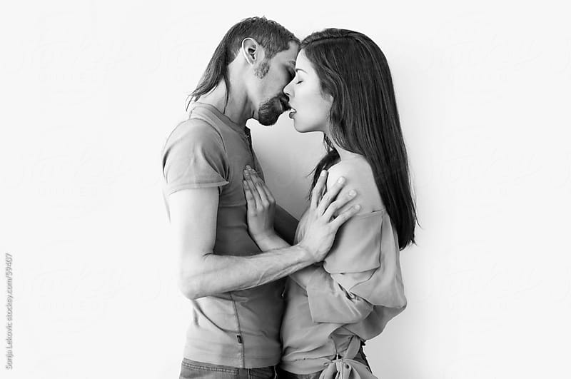 couple kissing by Sonja Lekovic for Stocksy United