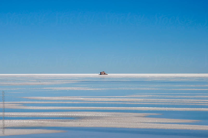 Disused building in the salt flats of Bolvia with a clear blue s by Mike Marlowe for Stocksy United