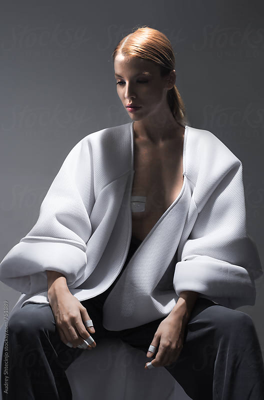 model in white minimalist kimono/portrait by Marko Milanovic for Stocksy United