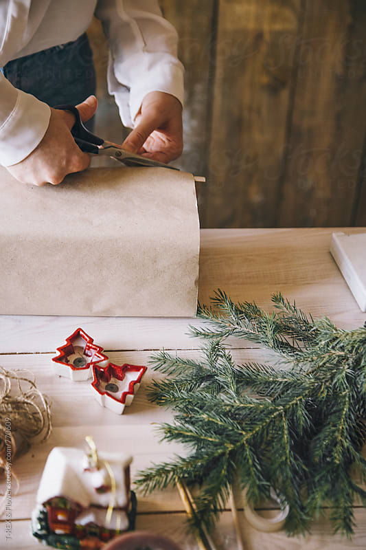 Woman cutting wrapping paper by Danil Nevsky for Stocksy United