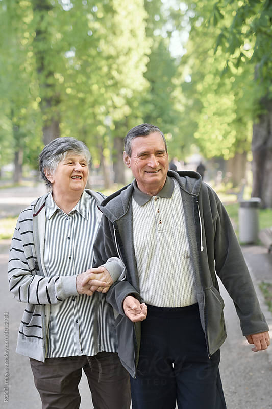 Happy senior couple walking outdoor by RG&B Images for Stocksy United