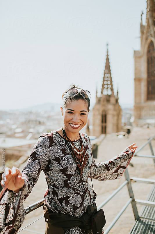 A happy young woman exploring the city of Barcelona, Spain by Kristen Curette Hines for Stocksy United