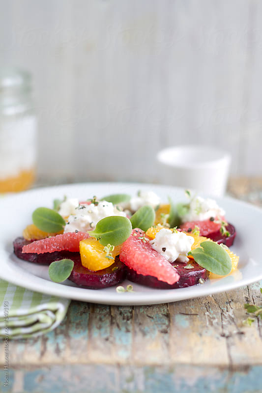 Baked beet salad with citrus by Noemi Hauser for Stocksy United