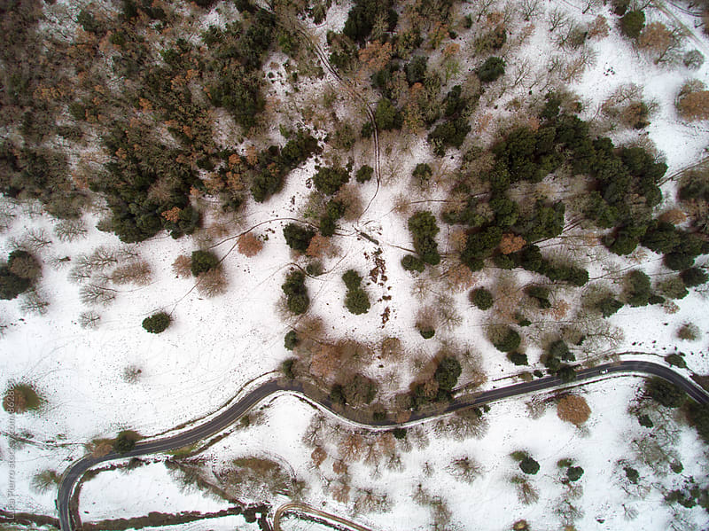 Snowy mountains from above by Luca Pierro for Stocksy United