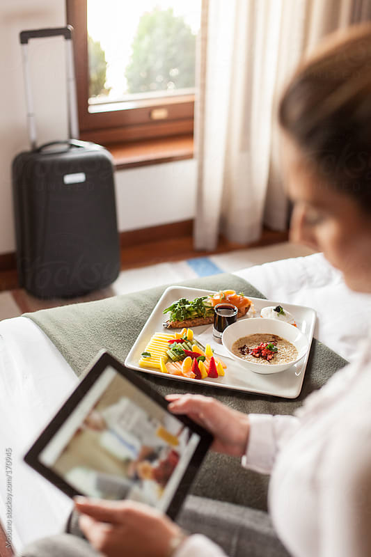 Businesswoman Having Breakfast in a Hotel Room by Mosuno for Stocksy United