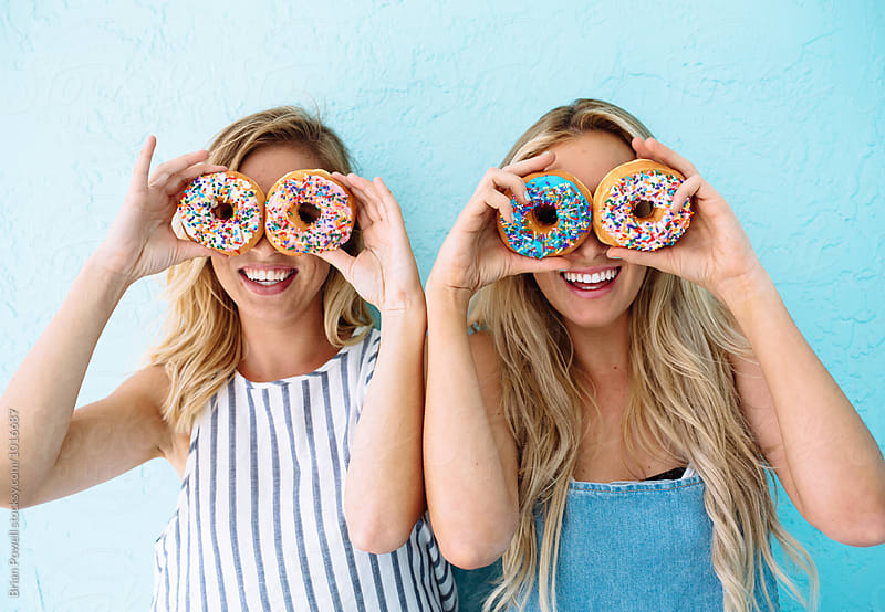 friends with donuts for eyes by Brian Powell for Stocksy United