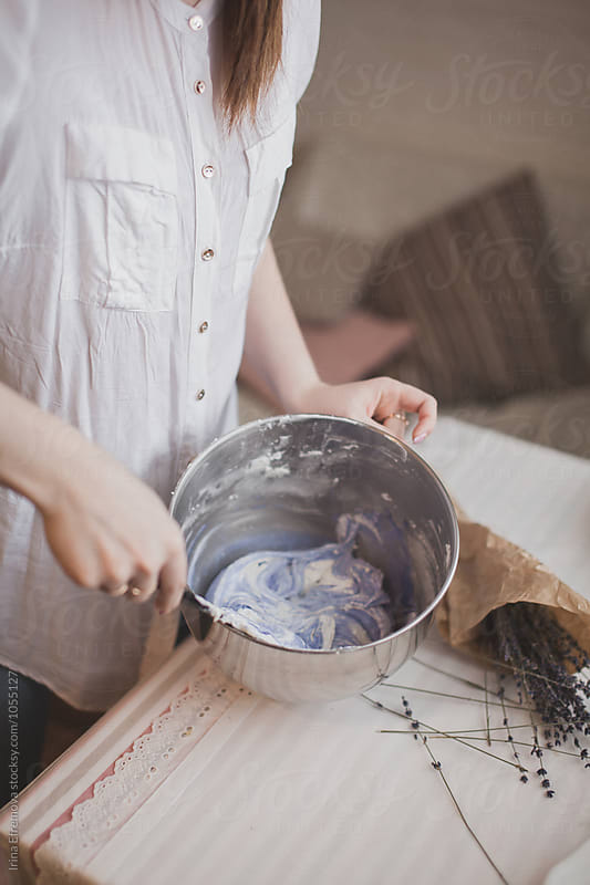 Woman mixing light purple pigment in a macaroon base by Irina Efremova for Stocksy United