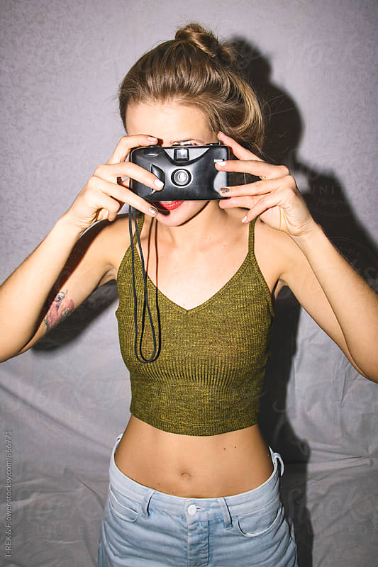 Woman holding old film camera by Danil Nevsky for Stocksy United