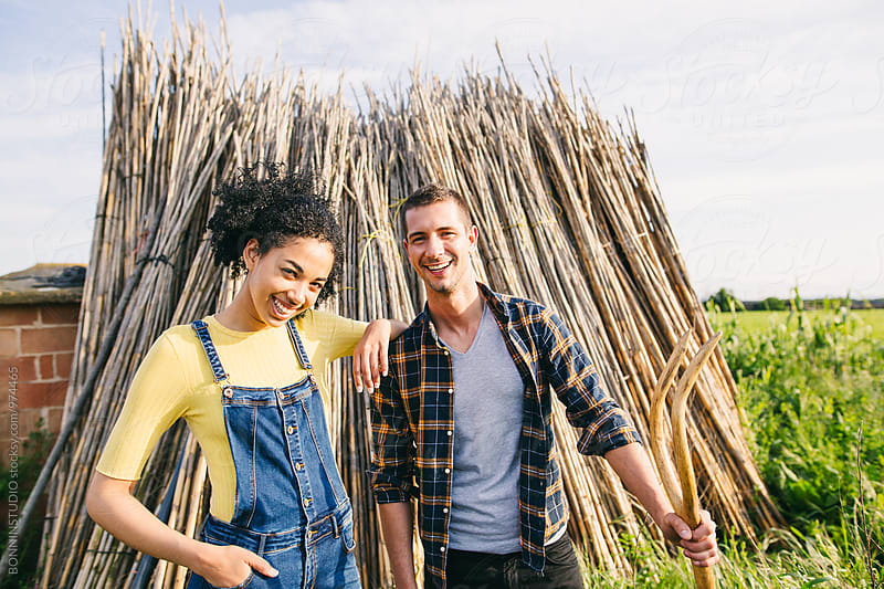 Portrait of farmer couple smiling in the garden. by BONNINSTUDIO for Stocksy United