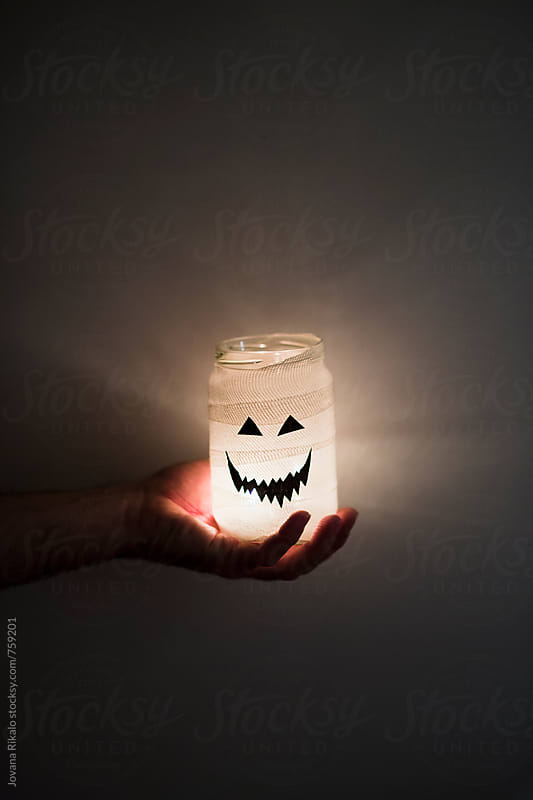 Man holding halloween jar by Jovana Rikalo for Stocksy United