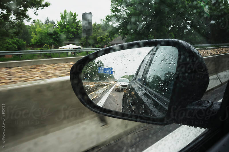 Car pushing from behind on German Autobahn by Mima Foto for Stocksy United