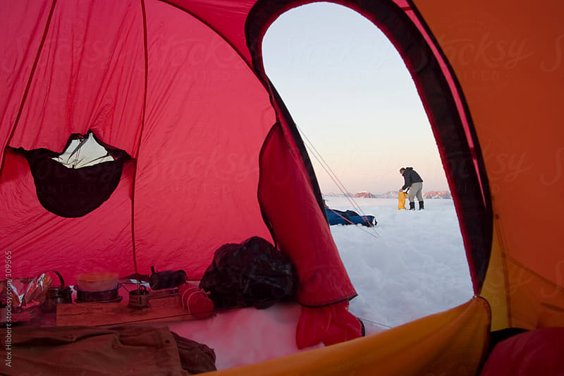 Scene of expedition life on a polar journey west of Kulusuk, Gre by Alex Hibbert for Stocksy United
