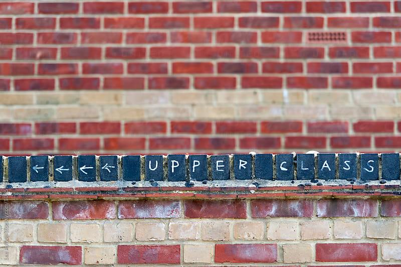 chalk graffiti reading 'upper class'  by Lee Avison for Stocksy United