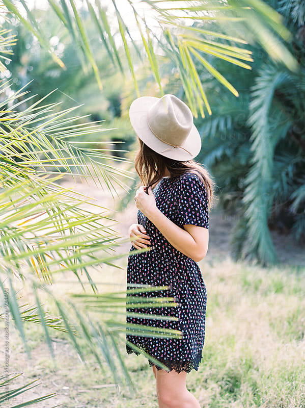 Pregnant woman in nature by Daniel Kim Photography for Stocksy United