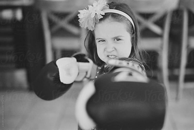 Cute you girl posing with boxing gloves by Jakob for Stocksy United
