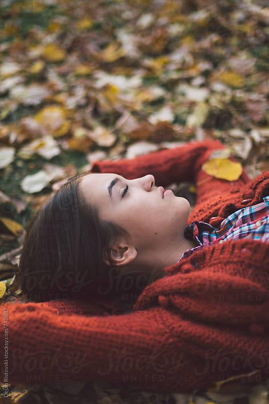 Girl resting in autumn park by Dejan Ristovski for Stocksy United