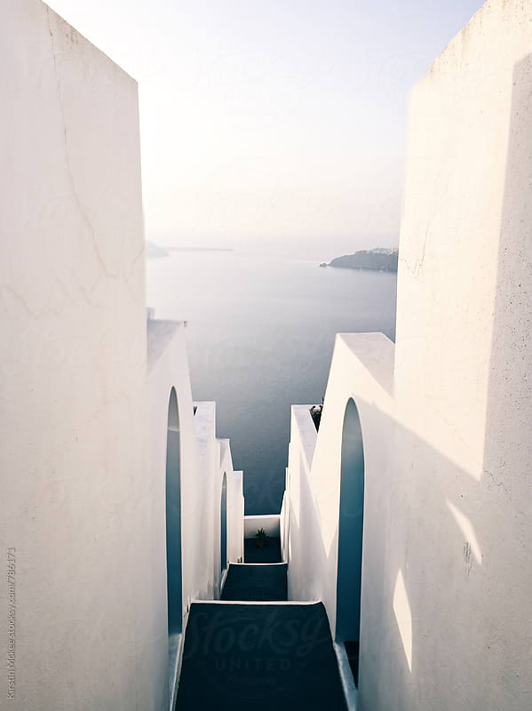 Alleyway at sunset, Santorini by Kirstin Mckee for Stocksy United