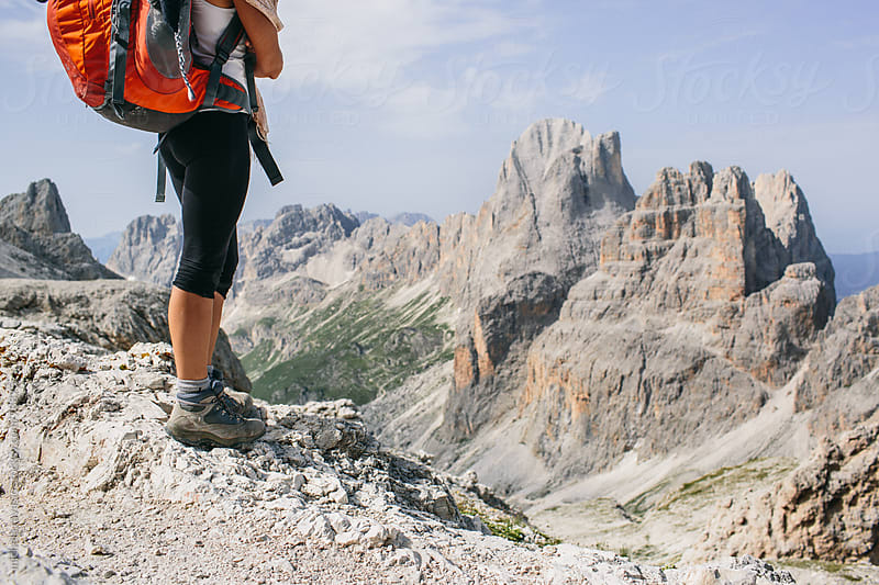 Woman hiker resting on top of a mountain by michela ravasio for Stocksy United