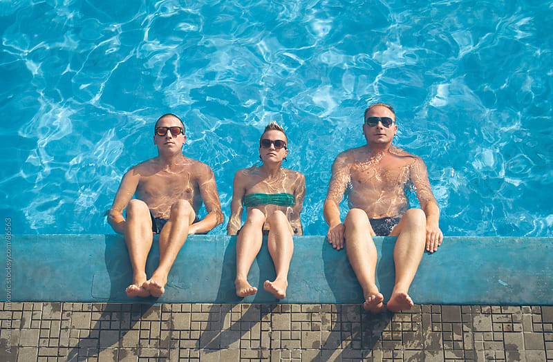 Three friends relaxing by the pool by Aleksandra Jankovic for Stocksy United