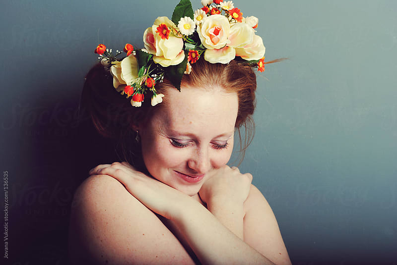 young girl with flower wreath by Jovana Vukotic for Stocksy United