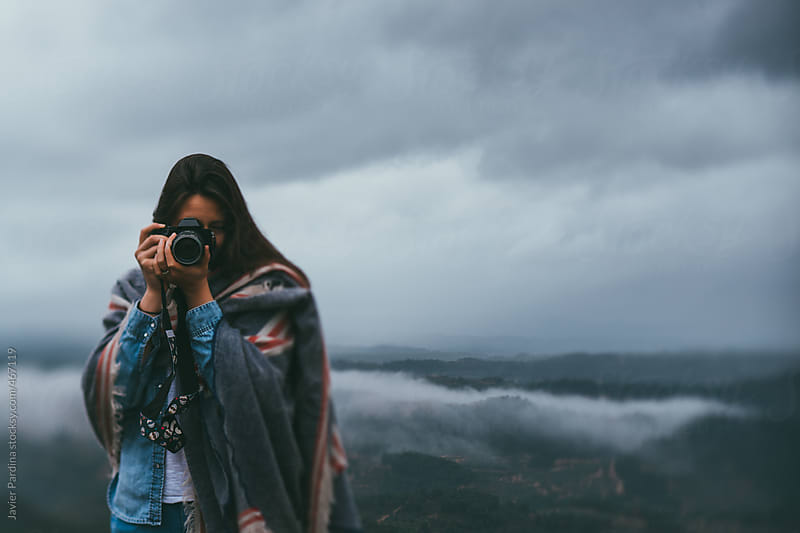 woman taking a photo by Javier Pardina for Stocksy United