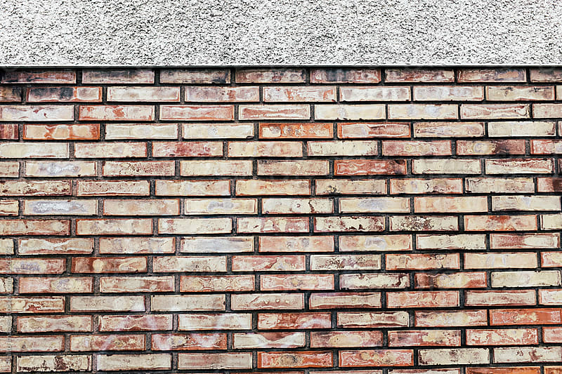 Brick wall exterior of urban building by Paul Edmondson for Stocksy United